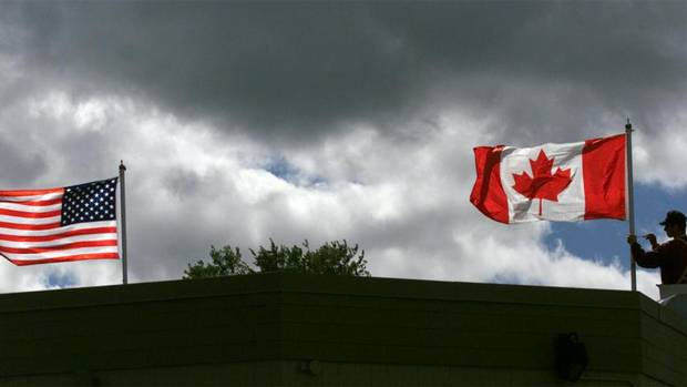 U.S. and Canadian flags at the Reversing Falls Information Centre in Saint John. (DAVID NICKERSON/CP)