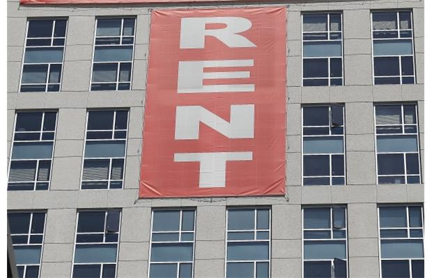 In a recent bulletin, the two report Canadian Mortgage and Housing Corporation numbers that demonstrate it's 32.5-per-cent cheaper to rent rather than own a one-bedroom unit in Vancouver. Photograph by: Justin Sullivan, Getty Images
