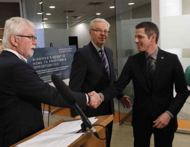 From left, Ross McGowan, president and CEO CentreVenture Development Corporation, Premier Greg Selinger and Mayor Brian Bowman at the announcement that applications are being taken for the new incentive program.