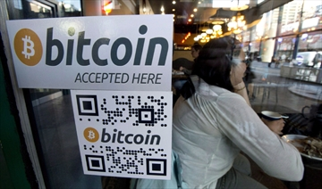 A Bitcoin ATM sticker is posted to the window of a coffee shop in Vancouver.