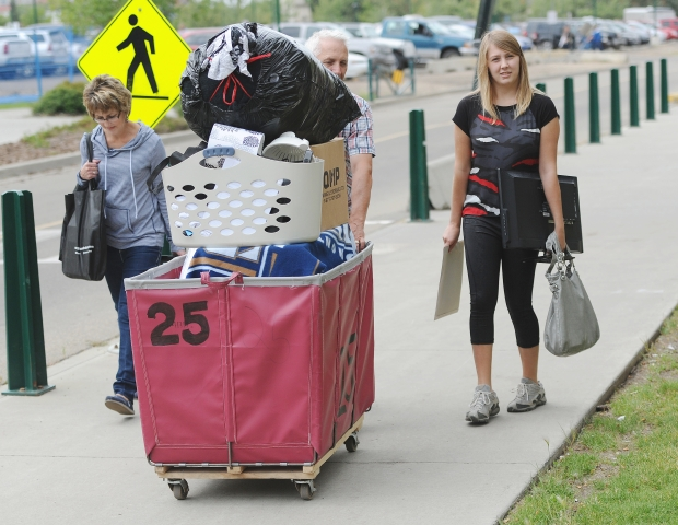 Alanna Craig, 18, from Westlock had help from her parents Shirley and Jim moving into the residence at MacEwan University downtown on Aug. 24, 2014. Photograph by: John Lucas , Edmonton Journal