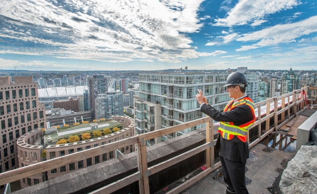 Mayor Gregor Robertson checks the view from the new Telus Garden at Richards and Georgia streets in Vancouver. Photograph by: Arlen Redekop , Province