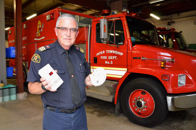 Inter Township firefighter Wayne Trimble holds two carbon monoxide alarms Wednesday, the day new Ontario Fire Code regulations require these devices in all residential accommodations with fuel-burning appliances or an attached garage. (Scott Dunn/QMI/Owen Sound)