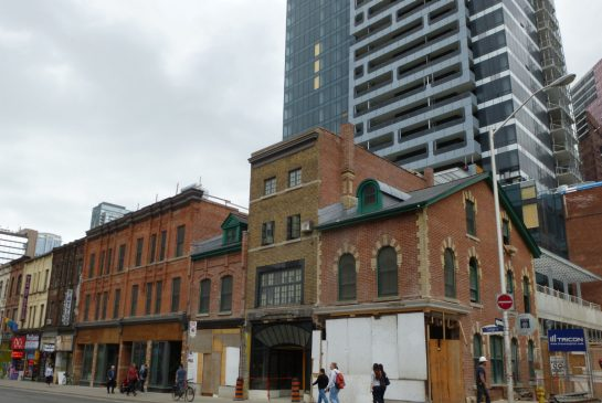 SUSAN PIGG/ TORONTO STAR Yonge and St. Joseph St., where MOD Developers has opted to build its condo towers atop a historic warehouse just behind a historic block of Yonge st. and have specialized heritage architects meticulously restore/build the stores in front of the condo tower.