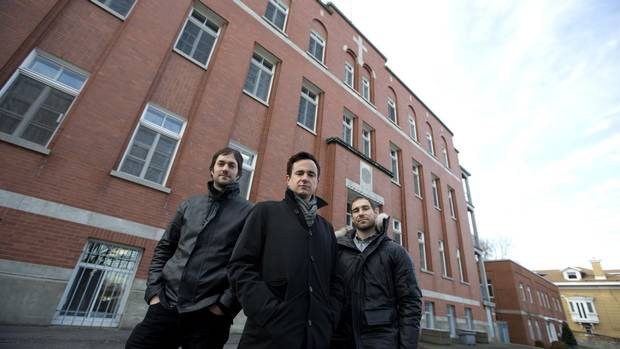 Partners Florent Moser (L), Ali Lakhdari (C) and David Lafrance of Demonfort, a development and construction firm, stand outside les Soeurs missionnaires de l'Immaculé-Conception, the convent they plan to convert to condos in Montreal, December 8, 2015. (Christinne Muschi for The Globe and Mail)
