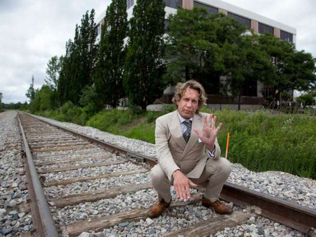 Former Bay St. trader Michael Wekerle, stands near one of the buildings he owns in Waterloo, Ont.