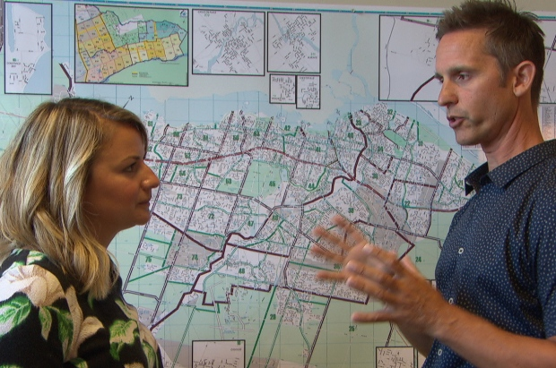 Charlie Sezlik, right, and staff often market Ottawa homes to foreign buyers. (CBC)