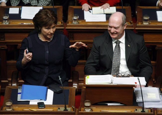 Premier Christy Clark chats with B.C. Finance Minister Mike de Jong before tabling the provincial budget in the Legislative Assembly, Tuesday, February 18, 2014 in Victoria, B.C. THE CANADIAN PRESS/Chad Hipolito