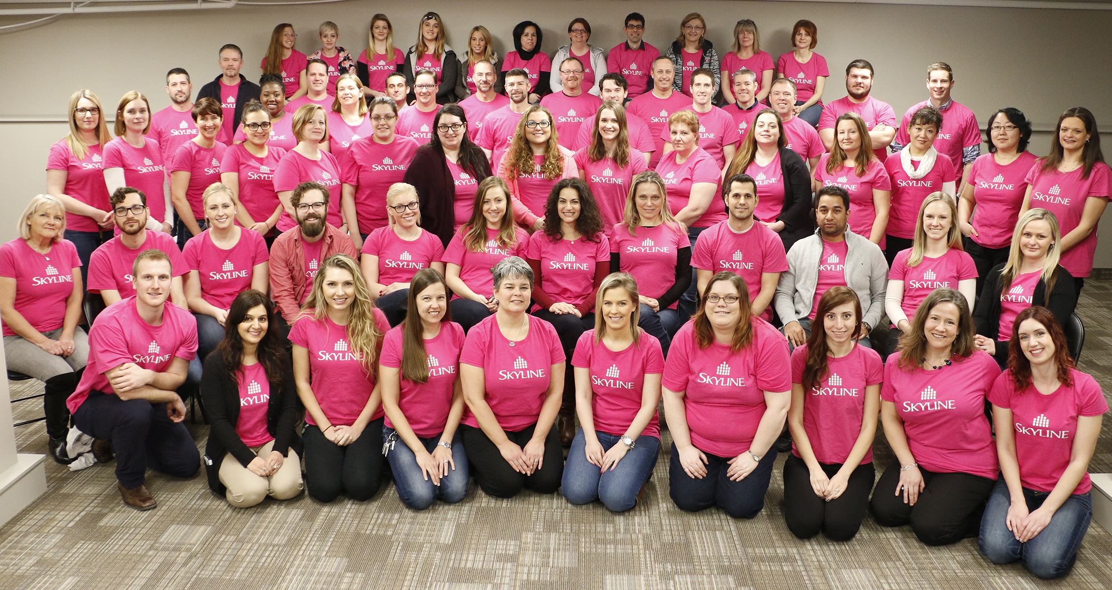 skyline-head-office-staff-in-pink-skyline-shirts