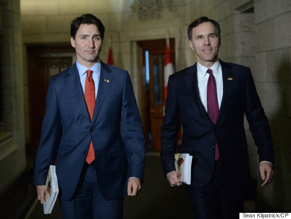 Minister of Finance Bill Morneau is accompanied by Prime Minister Justin Trudeau as he makes his way to deliver the federal budget in the House of Commons on Parliament Hill in Ottawa on Tuesday, March 22, 2016. THE CANADIAN PRESS/Sean Kilpatrick
