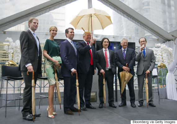Real estate investor Donald Trump, center, stands for a photograph with Eric Trump, from left, Ivanka Trump, Donald Trump Jr., Joo Kim Tiah, chief executive officer of Holborn Group, and Vancouver City Council member Geoff Meggs during an event in Vancouver, British Columbia, Canada, on Wednesday, June 19, 2013. Trump said the $360-million Trump International Hotel and Tower in Vancouver, to be built be built by Holborn Group, will be an architectural wonder and worth the price. Photographer: Ben Nelms/Bloomberg via Getty Images