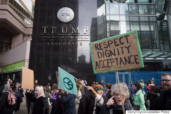 People march past the still under construction Trump International Hotel and Tower during a women's march and protest against U.S. President Donald Trump, in Vancouver, B.C., on Saturday January 21, 2017. Protests are being held across Canada today in support of the Women's March on Washington. Organizers say 30 events in all have been organized across Canada, including Ottawa, Toronto, Montreal and Vancouver. THE CANADIAN PRESS/Darryl Dyck