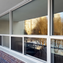 Phasing in Energy Efficiency: Why Your Multifamily Building Needs Fixed Over Slider Windows