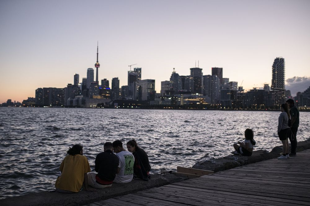 CANADA ADDS MOST NEW RESIDENTS IN YEARS AS RESTRICTIONS EASE