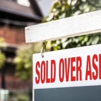INVESTORS ARE GOBBLING UP HOMES IN CANADA'S HOT HOUSING MARKET